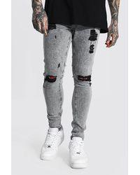 BoohooMAN Super Skinny Jeans mit mehreren Rissen - Grau