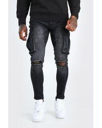 BoohooMAN Super Skinny Cargo-Jeans mit Knierissen - Schwarz