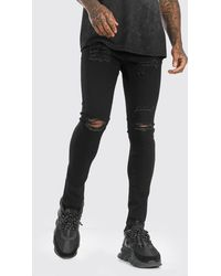 BoohooMAN Super Skinny Jeans With All Over Rips - Schwarz