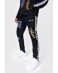 BoohooMAN Skinny Jeans aus Stretchmaterial mit Seitenstreifen - Schwarz