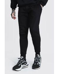 BoohooMAN Skinny Fit Jogginghosen aus recyceltem Material - Schwarz
