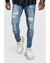 BoohooMAN Super Skinny Biker Jeans mit Bandana-Print, Rissen und Flicken - Blau