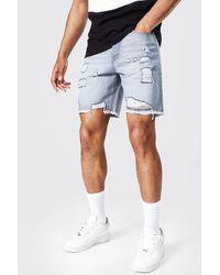BoohooMAN Short ample en jean déchiré - Gris