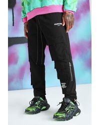 BoohooMAN Pantalon cargo Quavo avec cordon aux chevilles - Noir