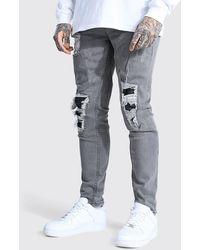 BoohooMAN Elastische Skinny Biker-Jeans im Wetlook - Grau