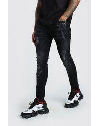 BoohooMAN Zerrissene Super Skinny Jeans mit Farbspritzern - Schwarz