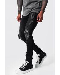 BoohooMAN Super Skinny Biker Jeans mit Rissen, Flicken und Tauben-Print - Schwarz