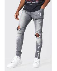 BoohooMAN Super Skinny Busted Knee Bleach Splatter Jean - Grau