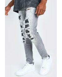 BoohooMAN Jean skinny déchiré imprimé bandana - Gris