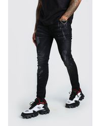 BoohooMAN Super Skinny Distressed Paint Splat Jeans - Black