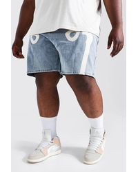 BoohooMAN Short en jean coupe ample appliqué squelette Plus - Bleu