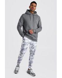 BoohooMAN MAN Hi-Lo-Hoodie und Jogginghose mit Reißverschlussdetail und Camouflagemuster - Grau