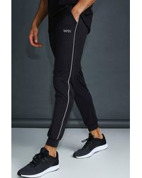 BoohooMAN MAN Skinny Tapered Jogger With Reflective Detail - Schwarz