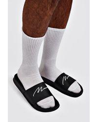 BoohooMAN Sandales avec inscription MAN - Noir
