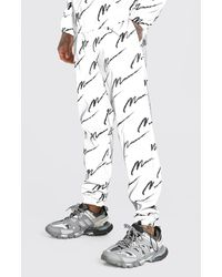 BoohooMAN - Reflective Shell All Over Man Print Jogger - Lyst