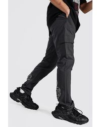 BoohooMAN Ofcl Shell Cargo Trouser With Bungee Cord - Grey