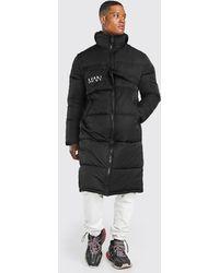 BoohooMAN Longline Puffer-Jacke mit MAN-Streifen und abnehmbarer Tasche - Schwarz