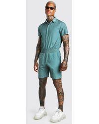 BoohooMAN Combinaison courte à poche et manches courtes - Bleu