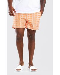 BoohooMAN Short de bain mi-long imprimé vertical MAN Grandes tailles - Orange