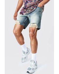 BoohooMAN Short en denim rigide coupe slim à déchirures extrêmes - Bleu