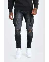BoohooMAN Super Skinny Cargo Jean With Knee Rips - Black