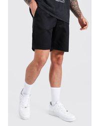 BoohooMAN Slim Chino-Shorts mit Man Gummi-Etikett - Schwarz