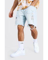 BoohooMAN Short en jean ample déchiré - Bleu