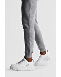 BoohooMAN Robuste Sneaker mit MAN-Print - Weiß