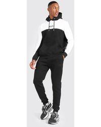 BoohooMAN Sweat à capuche et pantalon de survêtement color block à bande - Noir