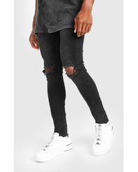 BoohooMAN Super Skinny Bleached Distressed Jeans - Noir