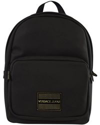 d62428671509 Versace Jeans - Black gold Stud Logo Backpack - Lyst