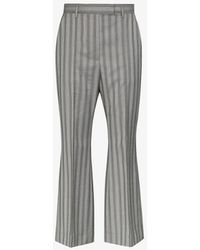 Acne Studios Pinstripe Flared Wool Trousers - Grey