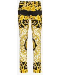 Versace - Baroque Low-rise Patterned Skinny Jeans - Lyst