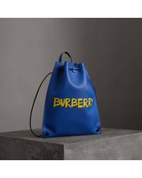 Burberry - Graffiti Print Bonded Leather Drawcord Backpack - Lyst