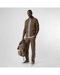 Burberry Poloshirt aus Baumwollpiqué mit Monogrammmuster im Streifendesign - Braun