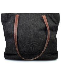Chanel Pre-Owned Black Denim Cc Tote - Lyst