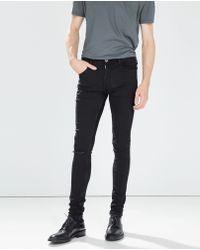 Zara Tight Ripped Skinny Trousers - Lyst