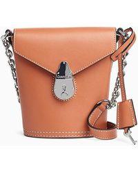 Calvin Klein Leren Mini Bucket Bag Met Slot - Bruin