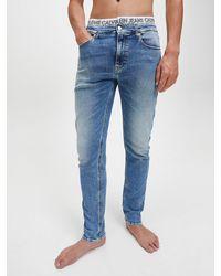 Calvin Klein Logo Waistband Slim Tapered Jeans - Blue