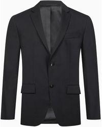 Calvin Klein - Blazer de lana el�stica ajustada con botonadura sencilla - Lyst