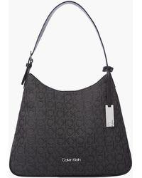 Calvin Klein Sac hobo en jacquard avec logo - Noir