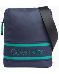 Calvin Klein Platte Crossover - Blauw