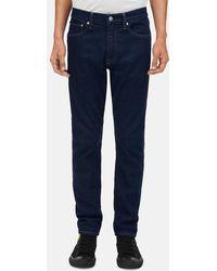 Calvin Klein Athletic Taper Jeans Met Warhol-portret - Blauw