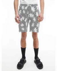 Calvin Klein Durchgehend bedruckte Shorts - Grau
