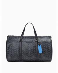 Calvin Klein Refined Monogram Logo Weekender Bag - Black