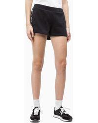 Calvin Klein Korte joggingbroek Met Logo En Tape - Zwart