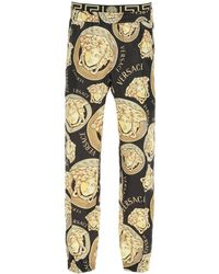 Versace - Amplified Medusa Print Trousers - Lyst