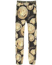 Versace Amplified Medusa Print Trousers - Multicolour
