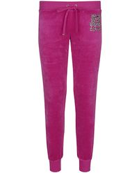 Juicy Couture Leopard Logo Track Pants - Lyst