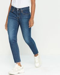 7f632ea33a4 Levi's 501® Cotton Ripped Tapered Jeans in Blue - Lyst